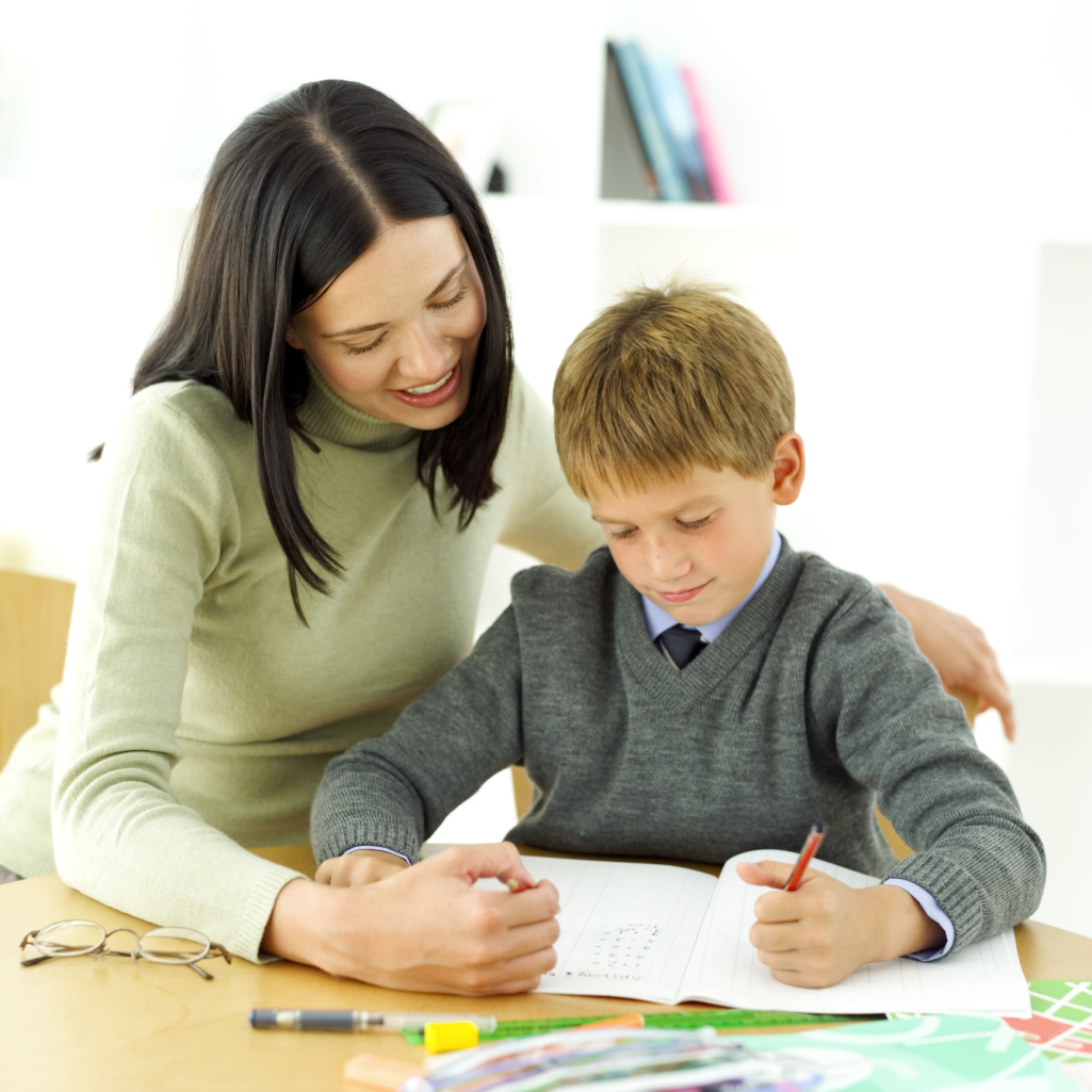 portrait of a young boy being tutored by his teacher