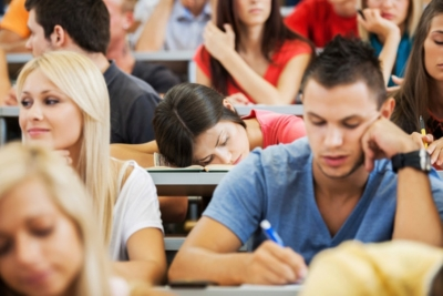 Young female student sleeping during a lecture.